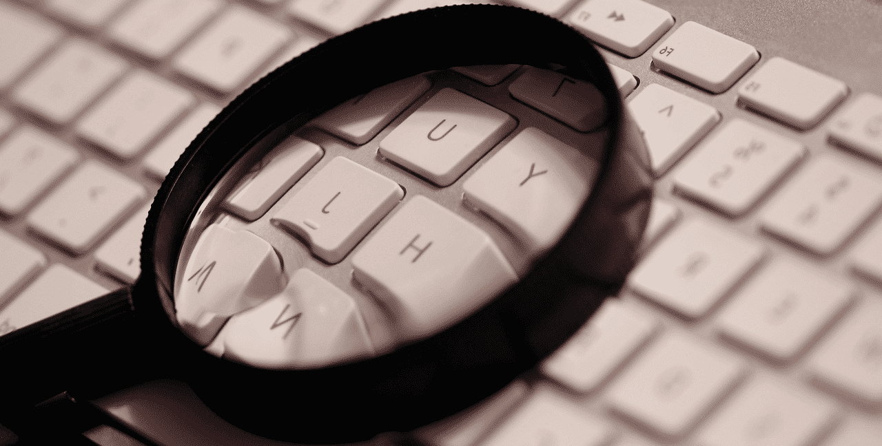 Magnifying glas on keyboard.
