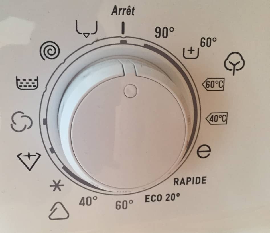 Many strange icons on a washing machine. Photo.